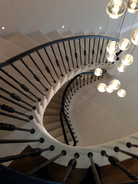 7. Moleanos cantilever stone staircase with spotlights – Surrey