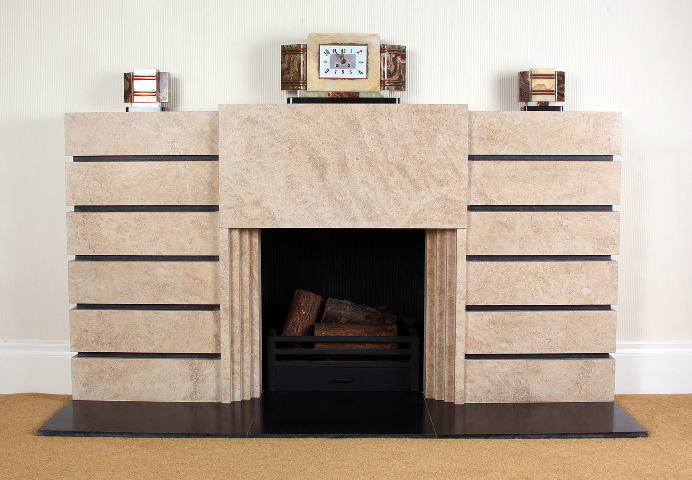 9. Art Deco fireplace in Ancaster Weatherbed with contrasting black granite detail – South Wales