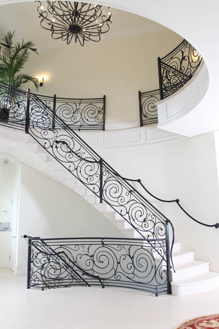 29. Two-storey Moleanos stone staircase in a new build country house – West Sussex