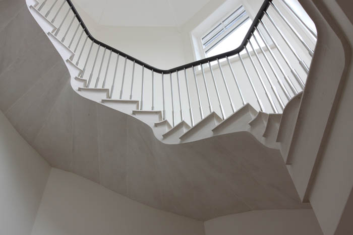 40. Cantilever staircase in Rosal stone with chrome balustrade and leather handrail – Nottinghamshire