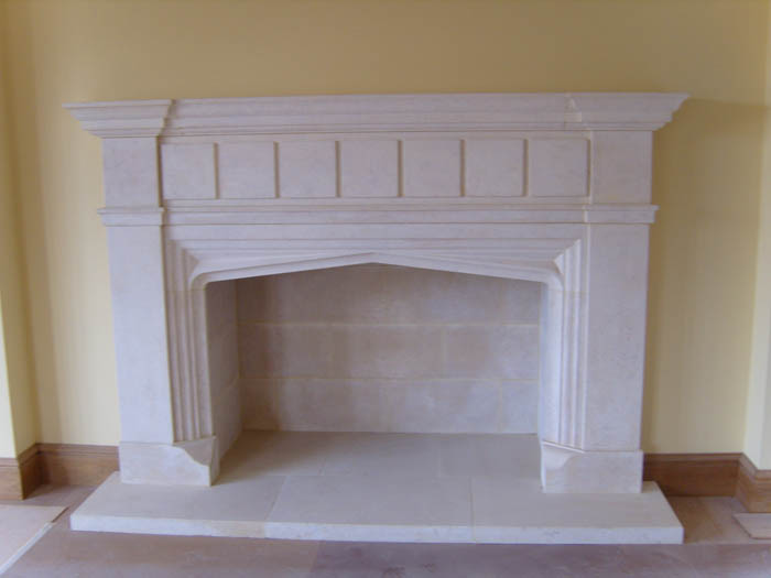 28. Lincolnshire stone fireplace, with gothic arch and stone lining to the chamber – Warwickshire
