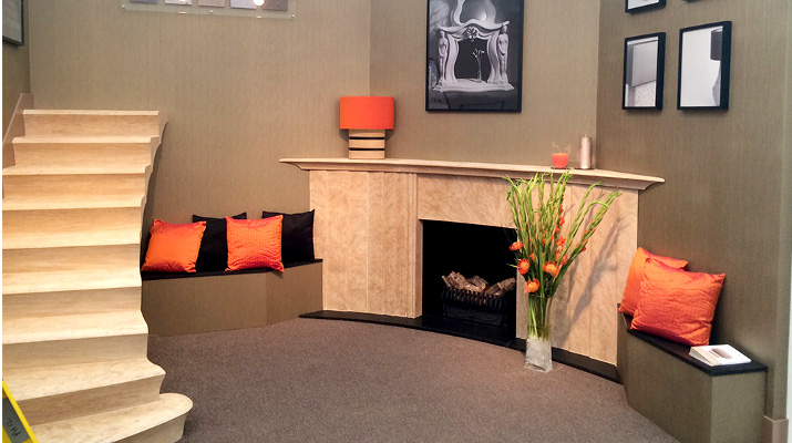 stone fireplace and stone staircase display - decorex