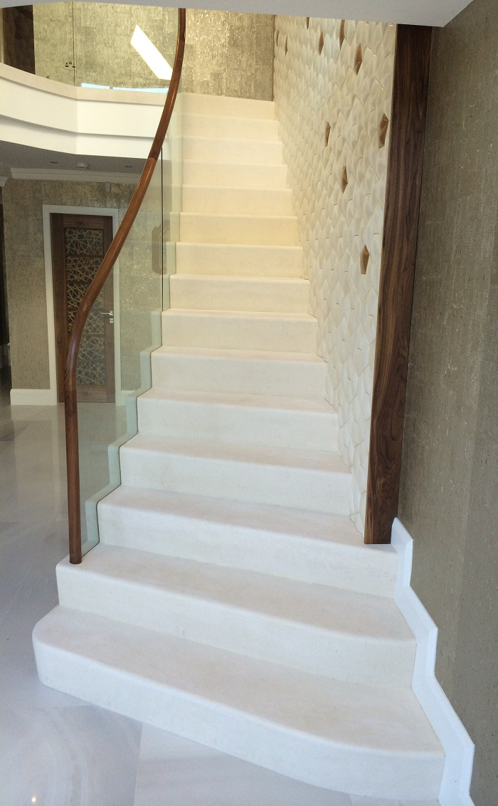 58. Moleanos staircase with glass balustrade, walnut handrail and water feature – Preston