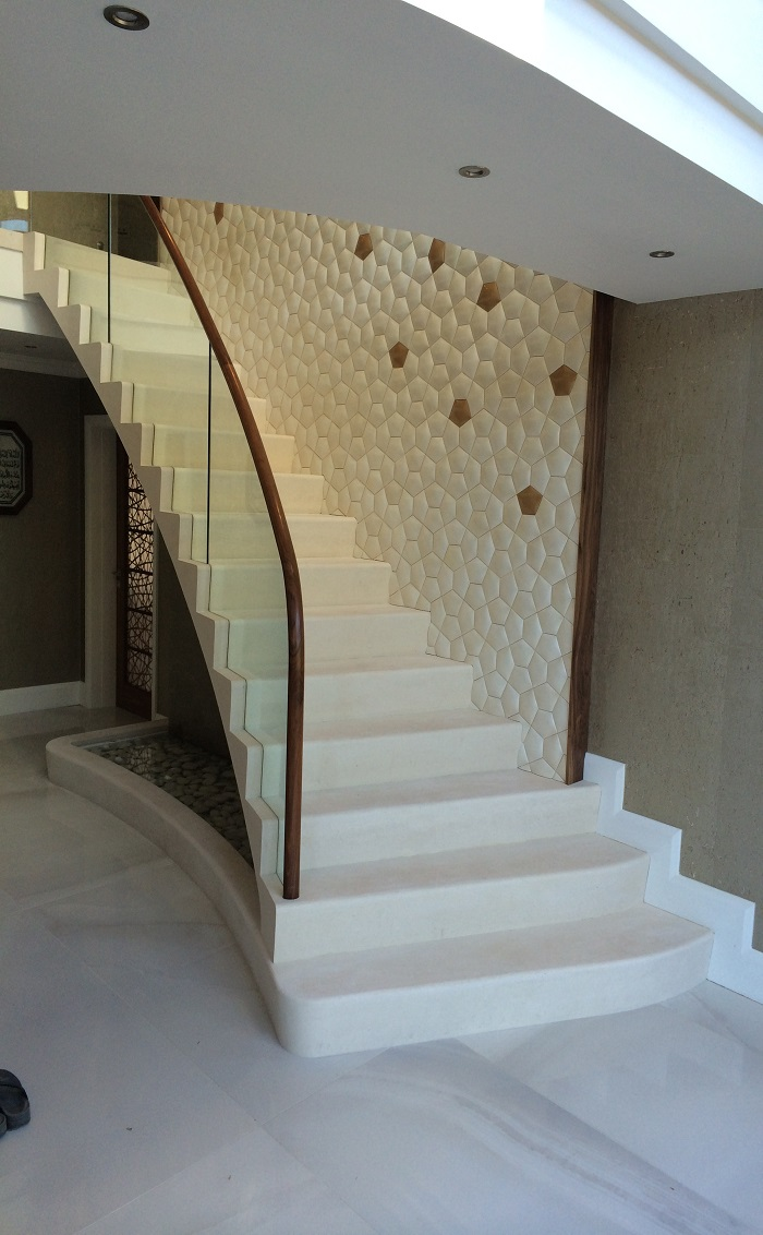 59. Moleanos staircase with glass balustrade, walnut handrail and water feature – Preston