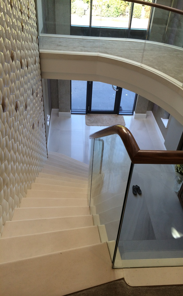 61. Moleanos staircase with glass balustrade, walnut handrail and water feature – Preston